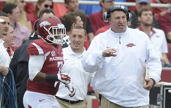 Bret Bielema, Arkansas head coach talks to Tiquention Coleman against Nicholls State in the first quarter Saturday, Sept. 6, 2014 at Razorback Stadium in Fayetteville.