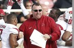 Arkansas' head coach Bret Bielema celebrates with Tiquention Coleman in the final moments of an NCAA college football game against Texas Tech in Lubbock, Texas, Saturday, Sept. 13, 2014. (AP Photo/Lubbock Avalanche-Journal, Tori Eichberger)