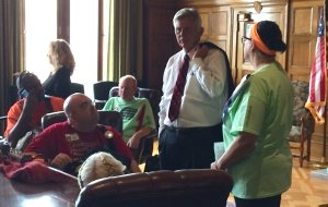 Gov. Mike Beebe addresses members of ADAPT, a disability rights group, in his conference room Monday morning. The group marched to the Capitol for the support of the Community First Choice Option.