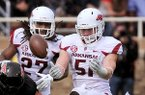 Arkansas linebacker Brooks Ellis (51) breaks up a pass during the second quarter a game against Texas Tech at Jones AT&T Stadium in Lubbock, Texas on Saturday Sept. 13, 2014.