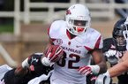 Arkansas running back Jonathan Williams carries the ball in the second quarter of the game in Jones AT&T Stadium in Lubbock, Texas on Saturday, Sept. 13, 2014.