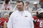 Arkansas coach Bret Bielema watches warmups before the first quarter of an NCAA college football game against Nicholls in Fayetteville, Ark., Saturday, Sept. 6, 2014. (AP Photo/Danny Johnston)