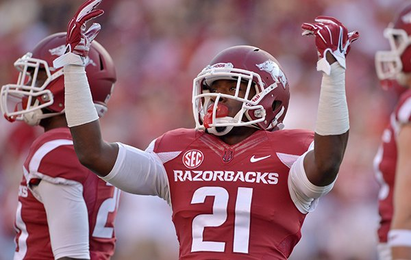 Arkansas cornerback Carroll Washington fires up the fans during the first quarter of the game against Northern Illinois at Reynolds Razorback Stadium in Fayetteville on Saturday, Sept. 20, 2014.