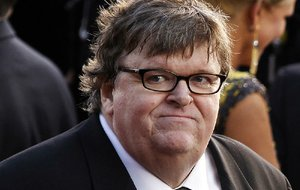 """FILE- In this Feb. 26, 2012, file photo, filmmaker Michael Moore arrives before the 84th Academy Awards in the Hollywood section of Los Angeles. Moore has filed for divorce after 21 years of marriage to Kathleen Glynn, his collaborator on the Oscar-winning """"Bowling for Columbine"""" and other projects. A final hearing is scheduled for Sept. 10, 2013. (AP Photo/Joel Ryan, File)"""