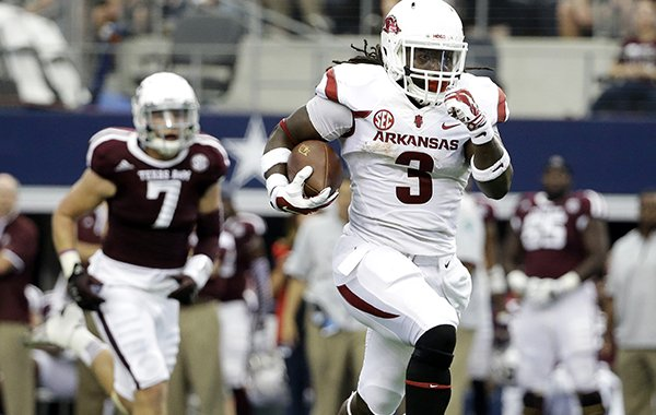 Arkansas running back Alex Collins (3) sprints past Texas A&M linebacker Jordan Mastrogiovanni (7) for a long run on his way to the end zone for a touchdown in the first half of an NCAA college football game, Saturday, Sept. 27, 2014, in Arlington, Texas. (AP Photo/Tony Gutierrez)