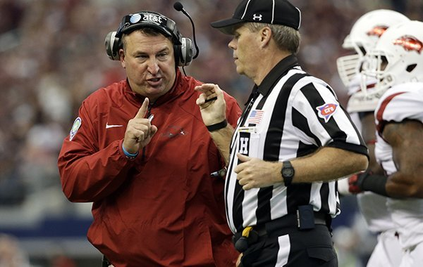Arkansas head coach Bret Bielema argues with an official after a Texas A&M touchdown in the first half of an NCAA college football game, Saturday, Sept. 27, 2014, in Arlington, Texas. (AP Photo/Tony Gutierrez)