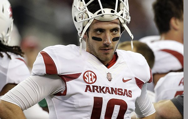 Arkansas quarterback Brandon Allen stands on the sideline late in the second half of an NCAA college football game against Texas A&M, Saturday, Sept. 27, 2014, in Arlington, Texas. The Aggies won in overtime 35-28. (AP Photo/Tony Gutierrez)
