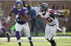 Minnesota Vikings wide receiver Jarius Wright, left, runs from Atlanta Falcons strong safety William Moore, right, after making a reception during the first half of an NFL football game, Sunday, Sept. 28, 2014, in Minneapolis. (AP Photo/Ann Heisenfelt)