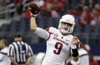 Arkansas quarterback Rafe Peavey passes during warm ups before an NCAA college football game against Texas A&M, Saturday, Sept. 27, 2014, in Arlington, Texas. (AP Photo/Tony Gutierrez)