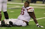 Arkansas offensive lineman Denver Kirkland sits on the field following a game against Texas A&M on Saturday, Sept. 27, 2014 at AT&T Stadium in Arlington, Texas.
