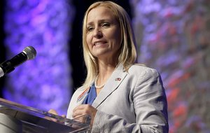Leslie Rutledge, Republican nominee in the race for Arkansas attorney General, speaks at the Republican Party of Arkansas state convention in Hot Springs, Ark., Saturday, July 19, 2014.