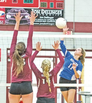 STAFF PHOTO ANTHONY REYES • @NWATONYR Emily Sherrill, Rogers High senior, spikes against Springdale on Tuesday at Bulldog Gymnasium in Springdale. Rogers won in straight sets.