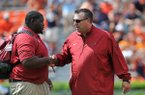 Arkansas head coach Bret Bielema, right, talks with graduate assistant coach Alfred Davis prior to a game Saturday, Aug. 30, 2014 at Jordan-Hare Stadium in Auburn, Alabama.