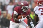 Arkansas running back Alex Collins looks for a running lane during the Razorbacks' game against Alabama on Saturday, Oct. 11, 2014 at Razorback Stadium in Fayetteville.