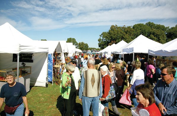Couple attends fair for 45th year nwadg for Craft fair fayetteville ar