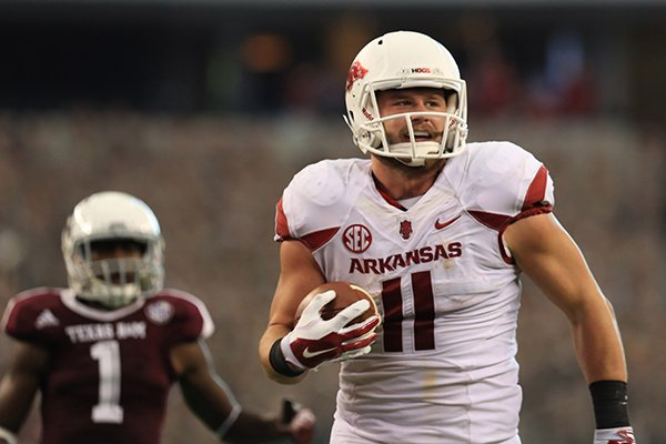 Arkansas tight end AJ Derby runs for a touchdown during the third quarter of a game against Texas A&M on Saturday, Sept. 27, 2014 at AT&T Stadium in Arlington, Texas.