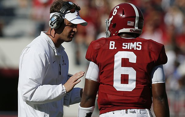 Offensive coach Lane Kiffin speaks with Alabama quarterback Blake Sims (6) during the first half of an NCAA college football game on Saturday, Oct, 18, 2014, in Tuscaloosa, Ala. (AP Photo/Brynn Anderson)