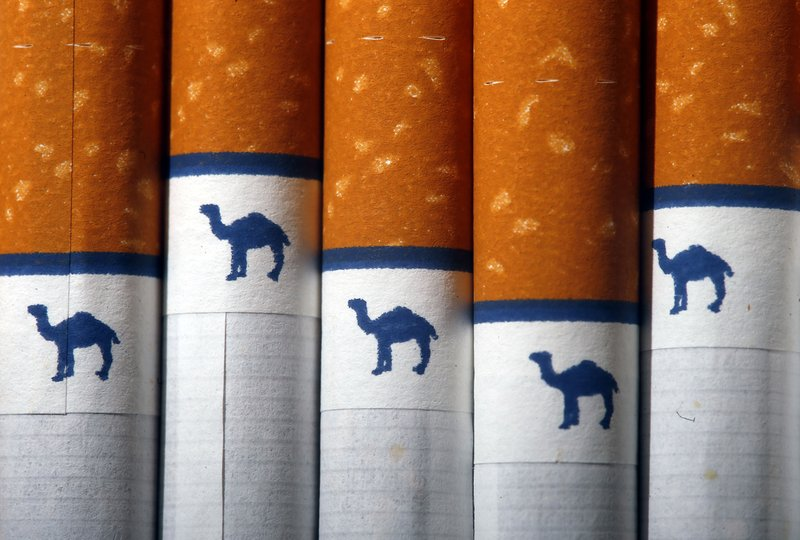 Tobacco firm cuts smoking in workplace
