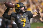 Missouri quarterback Maty Mauk throws a pass as he warms up before the start of an NCAA college football game against Vanderbilt, Saturday, Oct. 25, 2014, in Columbia, Mo. (AP Photo/L.G. Patterson)