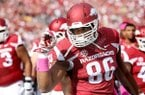 Arkansas defensive end Trey Flowers warms up prior to a game against Georgia on Saturday, Oct. 18, 2014 at War Memorial Stadium in Little Rock.