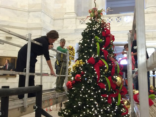 leighanne-harvey-with-the-state-capitol-gift-shop-and-carla-minchew-with-bella-flora-florist-work-on-the-25-foot-faux-rockefeller-pine-christmas-tree-in-the-state-capitol-on-wednesday-afternoon