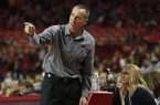 Arkansas coach Jimmy Dykes motions while assistant coach Christy Smith watches from the sideline during a game against Nicholls on Friday, Nov. 14, 2014 at Bud Walton Arena in Fayetteville.