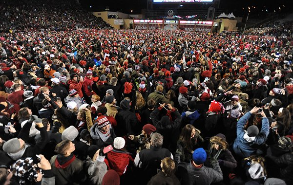 Arkansas fans rush onto the field after beating LSU Saturday, Nov. 15, 2014, at Razorback Stadium in Fayetteville.