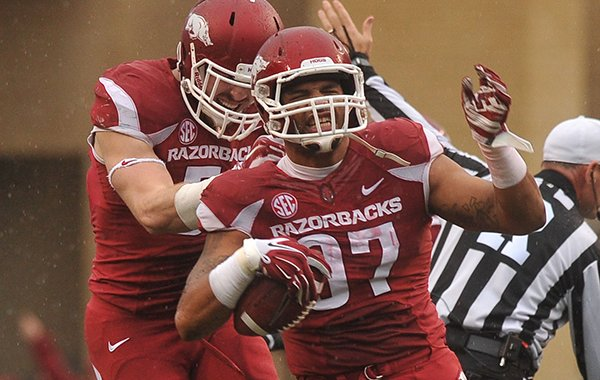 Arkansas defensive end Tevin Beanum reacts after recovering a fumble during the first quarter of a game against Ole Miss on Saturday, Nov. 22, 2014 at Razorback Stadium in Fayetteville.