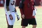 NWA Media/ANDY SHUPE - Arkansas defensive coordinator Robb Smith speaks to defensive back Kevin Richardson during practice Thursday, March 20, 2014, at the UA practice field in Fayetteville.