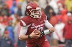 Arkansas quarterback Brandon Allen scrambles during the first half of a game against Ole Miss on Saturday, Nov. 22, 2014 at Razorback Stadium in Fayetteville.