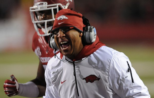 Arkansas assistant coach Michael Smith argues with a game official against LSU during the third quarter Saturday, Nov. 15, 2014, at Razorback Stadium in Fayetteville.