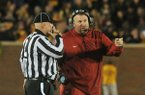 Arkansas coach Bret Bielema talks to an official during the second half of a game against Missouri on Friday, Nov. 28, 2014 at Faurot Field in Columbia, Mo.