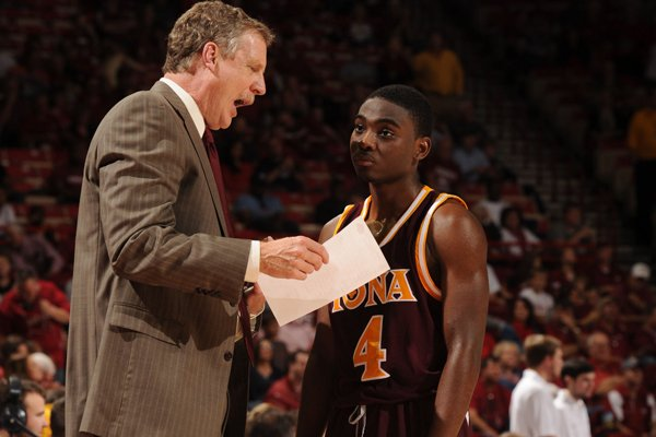 Iona coach Tim Cluess speaks to Schadrac Casimir against Arkansas during the first half Sunday, Nov. 30, 2014, in Bud Walton Arena in Fayetteville.