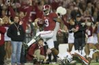 Alabama wide receiver Amari Cooper (9) scores a 75-yard touchdown reception as Auburn defensive back Jonathon Mincy (6) attempts to tackle him during an NCAA college football game, Saturday, Nov. 29, 2014 in Tuscaloosa, Ala. (AP Photo/The Montgomery Advertiser, Albert Cesare)