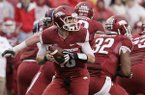 Arkansas quarterback Brandon Allen, center, looks for a receiver in the second quarter of an NCAA college football game against Mississippi Saturday, Nov. 22, 2014, in Fayetteville, Ark. (AP Photo/Danny Johnston)