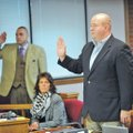 Josh Melton, right, of Fayetteville, is sworn in during the first day of his trial Monday at the Wa...