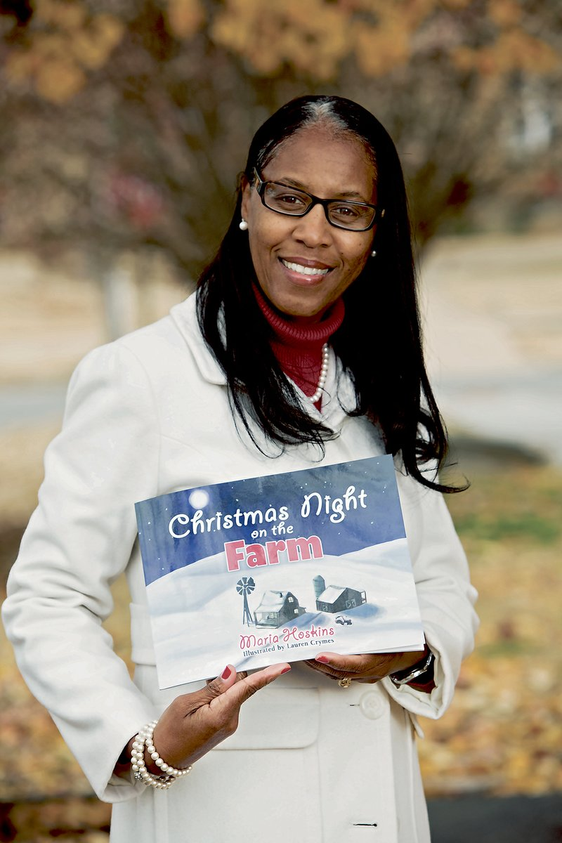 eed2c401 Maria Hoskins of Mayflower holds a copy of Christmas Night on the Farm, a  book she self-published. She originally planned just to give a copy of the  story ...