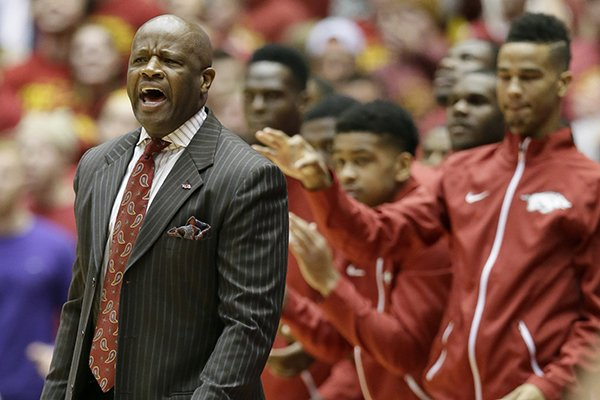 Arkansas head coach Mike Anderson reacts during the first half of an NCAA college basketball game against Iowa State, Thursday, Dec. 4, 2014, in Ames, Iowa. (AP Photo/Charlie Neibergall)