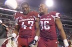 Arkansas linebacker Martrell Spaight (47) and defensive end Trey Flowers (86) walk from the field after an NCAA college football game Saturday, Nov. 22, 2014, in Fayetteville, Ark. Arkansas defeated Mississippi 30-0. (AP Photo/David Quinn)