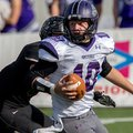 Fayetteville sophomore quarterback Taylor Powell evades a sack attempt from Bentonville senior lineb...