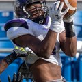 Fayetteville senior wide receiver Dre Greenlaw makes a reception over the defense from Bentonville j...