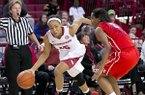 Arkansas guard Kelsey Brooks drives past Rutgers guard Tyler Scaife during a game Sunday, Dec. 7, 2014 at Bud Walton Arena in Fayetteville.