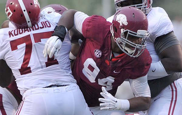 Arkansas defensive tackle Taiwan Johnson breaks through the Alabama offensive line during a game Saturday, Oct. 11, 2014 at Razorback Stadium in Fayetteville.