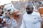 Texas coach Charlie Strong takes the field prior to a game against North Texas on Saturday, Aug. 30, 2014 at Darrell K. Royal - Texas Memorial Stadium in Austin, Texas. (AP Photo/Eric Gay)