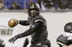 Charleston quarterback Ty Storey passes in the first quarter of the Arkansas Class 3A High School Championship football game against Smackover in Little Rock, Ark., Friday, Dec. 12, 2014. (AP Photo/Danny Johnston)