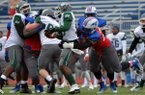 Hutchinson Community College defensive end Jeremiah Ledbetter tackles a Hudson Valley quarterback during a 2014 game.