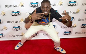 In this Oct. 30, 2014 file photo, Bobby Shmurda arrives at Power 105.1's Powerhouse 2014 at Barclays Center in Brooklyn, New York. Shmurda whose real name is Ackquille Pollard has been arrested in New York City in a gun and narcotics investigation. Authorities said Wednesday, Dec. 17, 2014, that he was apprehended after leaving a Manhattan recording studio. Several others were also taken into custody.