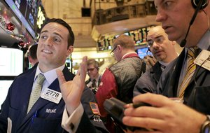 Traders watch stocks surge Thursday on the floor of the New York Stock Exchange.