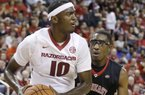 Arkansas's Bobby Portis (10) tries to get around Southeast Missouri State's Aaron Adeoye (24) in the second half of an NCAA college basketball game in North Little Rock, Ark., Saturday, Dec. 20, 2014. Arkansas defeated Southeast Missouri State 84-67. (AP Photo/Danny Johnston)