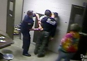 Reports, lockup's video tell 2 sides of broken arm